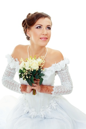Beautiful young bride in white dress and pearl necklace isolated on white background Stock Photo - 14284208