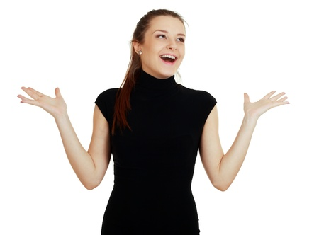 Portrait of an excited young lady in black dress hands up photo