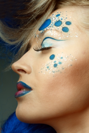 eyeshades: beautiful fashionable young woman with creative hairstyle with blue hairs and art make up