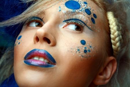 eyeshades: Gorgeous Young model beautiful women with perfect art make up and long false eyelashes. Focuse on lips.