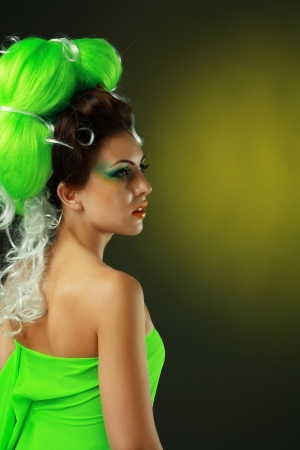 beautiful fashionable smiling young woman with creative hairstyle with green false hairs and art make up Stock Photo - 14284133