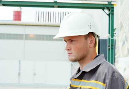 Industrial Worker, serious looking, controls work in a factory photo