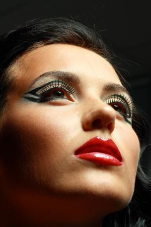 eyeshades: Gorgeous Young model beautiful women with perfect art make up and long false eyelashes. Stock Photo