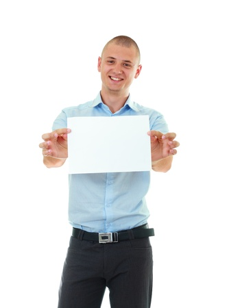 Happy bold young man holding blank card against white background photo