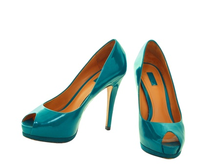 Pair of dress blue green women shoes isolated over white  photo