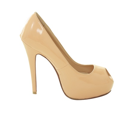 close up of a beige high heels on white background  photo