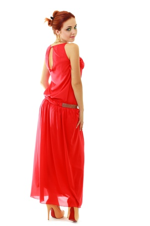 Beautiful red haired woman in red dress, white background photo
