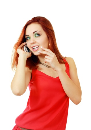 Pretty girl using cell phone smiles and looks over her shoulder out of frame photo