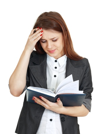 beautiful woman tired with office work trying to concetrate holding notebook and pen photo