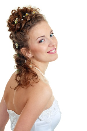 Attractive young bride with beautiful wedding hairstyle - isolated on white Stock Photo - 14697232