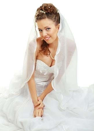 bride sitting in wedding dress under the veil, studio shot Stock Photo - 14697187