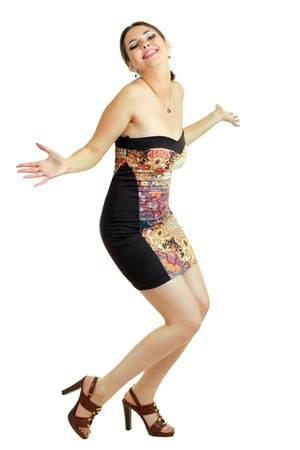 Isolated full length studio shot of a Caucasian beautiful woman  with arms raised and duck to curtsy