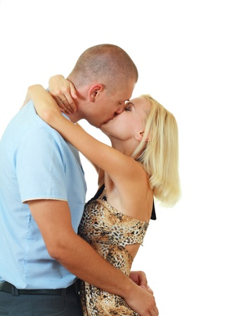couple in love kissing studio shoot ove white photo