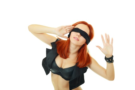 Fashion portrait of the young woman blindfold over white background photo