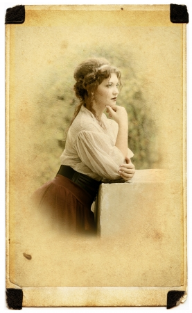 thoughtful Young lady weared in old fashion dress outdoor in old photo card photo