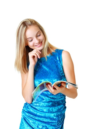 beautiful happy blond teenage girl looking on journal and smiling on white background photo