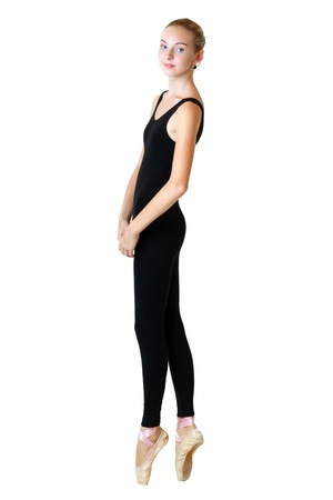 tricot: teen girl ballerina dancer in black tricot over white background
