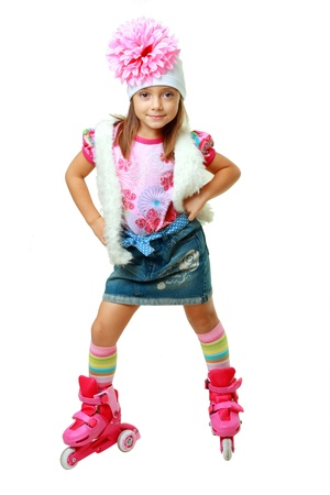 five years old girl on pink roller skates isolated over white background photo