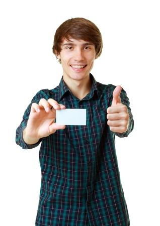 Jonge lachende man met lege witte kaart op te schrijven op je eigen tekst op een witte achtergrond Stockfoto