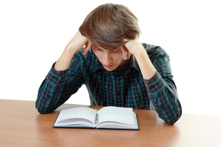 wearied: bored and tired student after hard work for exam Stock Photo