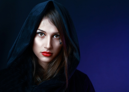 beautiful misteuse woman in black hood evil halloween witch look Stock Photo - 17047754