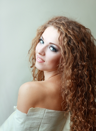 smoky eyes: Gorgeous Young model beautiful women with perfect make up smoky eyes weared in rug Stock Photo