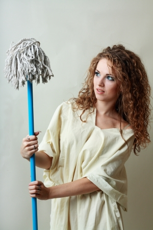 beautiful mad woman looking to the mop photo