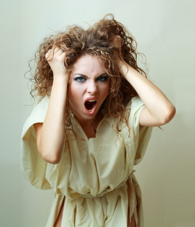 Beautiful angry insane psychopath woman  screaming  photo