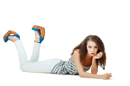 Young teen glamour girl laying on the floor isolated photo