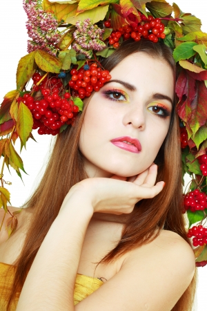 guelder rose berry: Autumn Woman close up. Beautiful makeup isolated over white background. viburnum berries Stock Photo