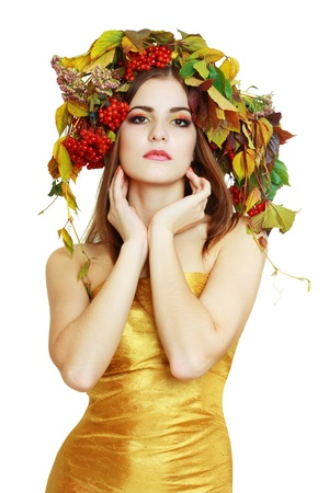 Autumn Woman in gold dress. Beautiful makeup isolated over white background. viburnum berries photo