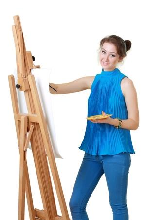 artistas: pintor mujeres j�venes con caballete aislado m�s de blanco Foto de archivo