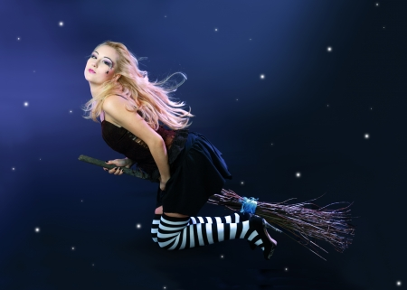 Sexy blond witch flying on broom on a dark sky with stars Stock Photo - 17047796