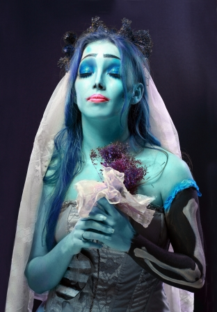 Halloween: Sorrow scene of a corpse bride under blue moon light photo