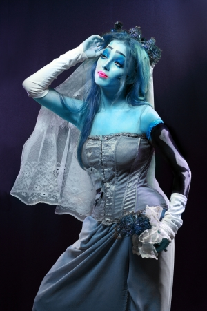 daunting: Halloween: Horror scene of a corpse bride under blue moon light