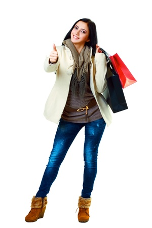 picture of lovely woman in jeans and winter clothes  with shopping bags  Stock Photo - 17065043