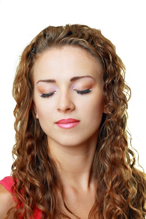 beautiful young woman face, curly hair. Clear fresh skin close up photo