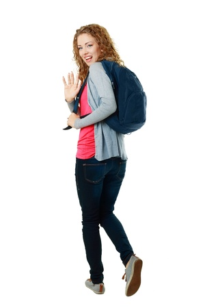 woman back of head: beautiful student girl walking away and saing bye-bye Stock Photo