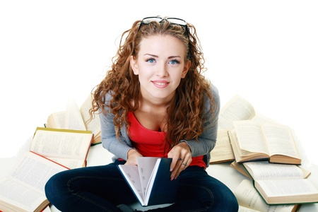 Friendly College student girl sitting and meditating with books down the floor isolated Stock Photo - 17047811