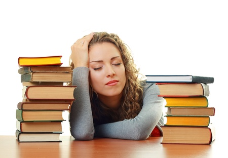 Friendly College student girl sleeping  near books at the desk isolated Stock Photo - 17047800