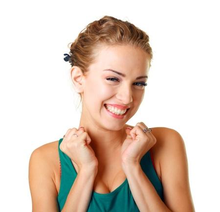 donna entusiasta: Ritratto di una giovane donna sorpresa con le mani davanti alla bocca ridere contro sfondo bianco Archivio Fotografico