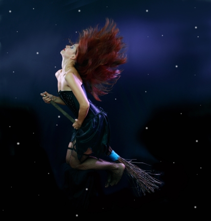 Sexywitch flying on broom on a dark sky with stars Stock Photo - 17068151