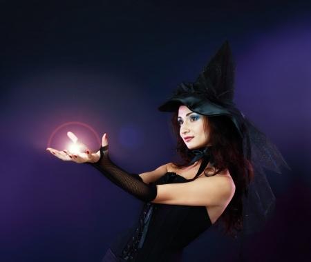 girl magic wand: Fantasy magic portrait of sexy beautiful woman making spell with magic fireball