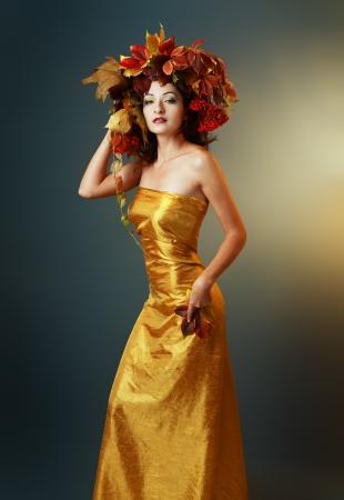 quin: beautiful asian woman in golden dress  Quin autumn