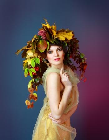 Autumn Woman  Beautiful makeup  Golden dress  Dark blue and purple color background Stock Photo - 17067674