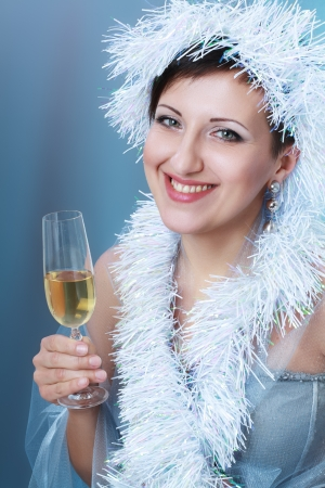 beautiful young woman with creative white hat drinking Champagne Stock Photo - 17098848