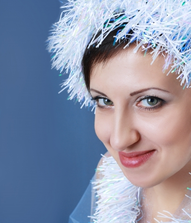 snow-queen. Young woman in decorative cap looking to the camera close up face Stock Photo - 17098846