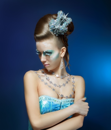 Ice-queen. Young woman in creative image with silver blue artistic make-up and perfect hairstyle. Stock Photo - 17130129