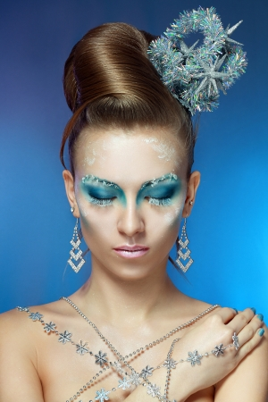 Ice-queen. Young woman in creative image with silver blue artistic make-up and perfect hairstyle. Stock Photo - 17130137