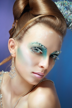 ice-queen. Young woman in creative image with silver artistic make-up. Stock Photo - 17130136